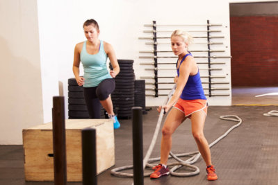 two females doing some physical activities