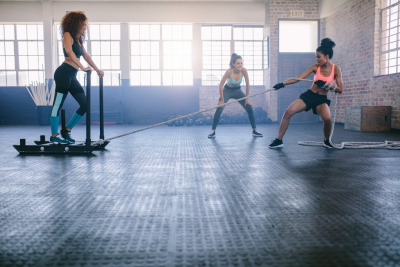 three young women doing physical training