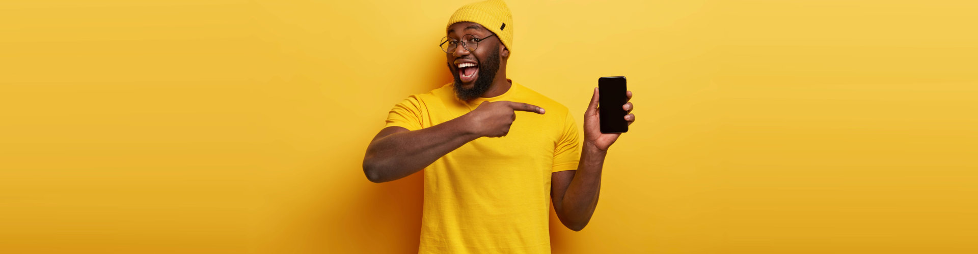 man holding and pointing his phone
